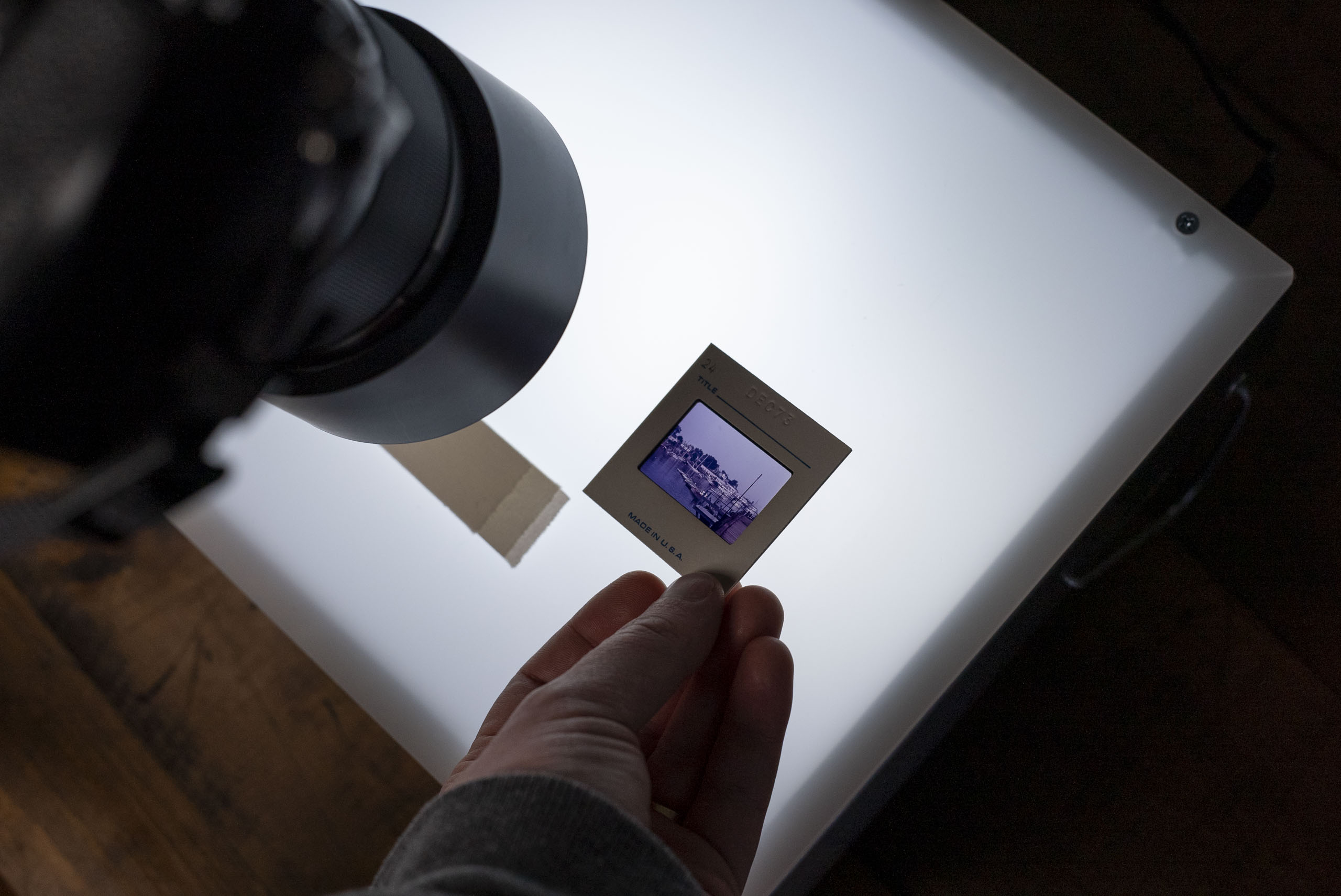 You should minimize handling film with your bare hands unless it already has some form of protection, such as a holder. Otherwise grease and oils from your hand can damage the film. Be careful!