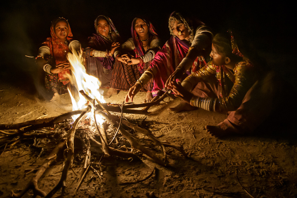 Meghwal women gathered around a fire, Gujarat, India.  Canon EOS-1D X, EF24-105mm f/4L IS USM lens, f/4 for 1/20 second, ISO 4000