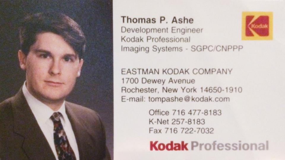 Portrait of Tom Ashe on his Kodak business card from the late 1990s.