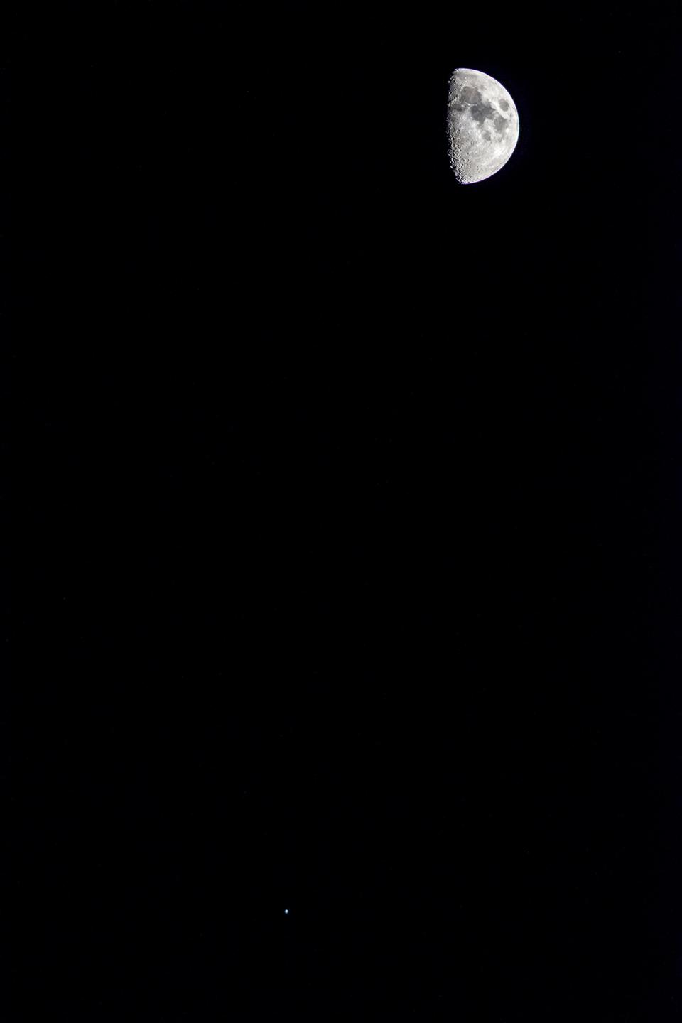 The Moon and Jupiter hang out together in a small patch of sky. Image taken with a FUJIFILM X-T2; Nikon AF-S NIKKOR 300mm f/4D IF-ED lens at f/4; 1/2000-second; ISO1600.