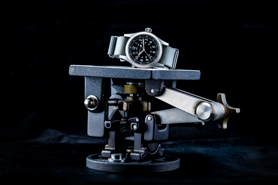 The Hamilton Khaki Field Mechanical H69439931with BluShark NATO Strap on top of a Ries tripod head.