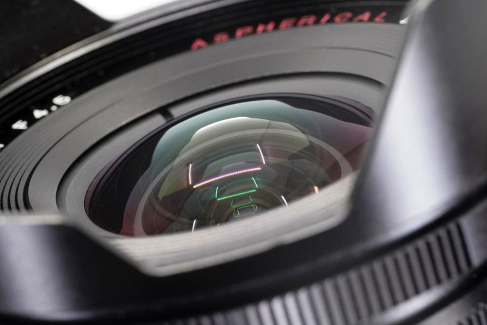 At wider apertures, curved-field lenses tend to be noticeably sharper at the center of the frame compared to the edges of the frame. If you want sharp edges, you must stop the lens down, which unless we are shooting under low light or want shallow depth of field is something we do regardless. The front elements of curved-field lenses are shaped more like a fishbowl compared to the flatter front elements on flat-field macro lenses.
