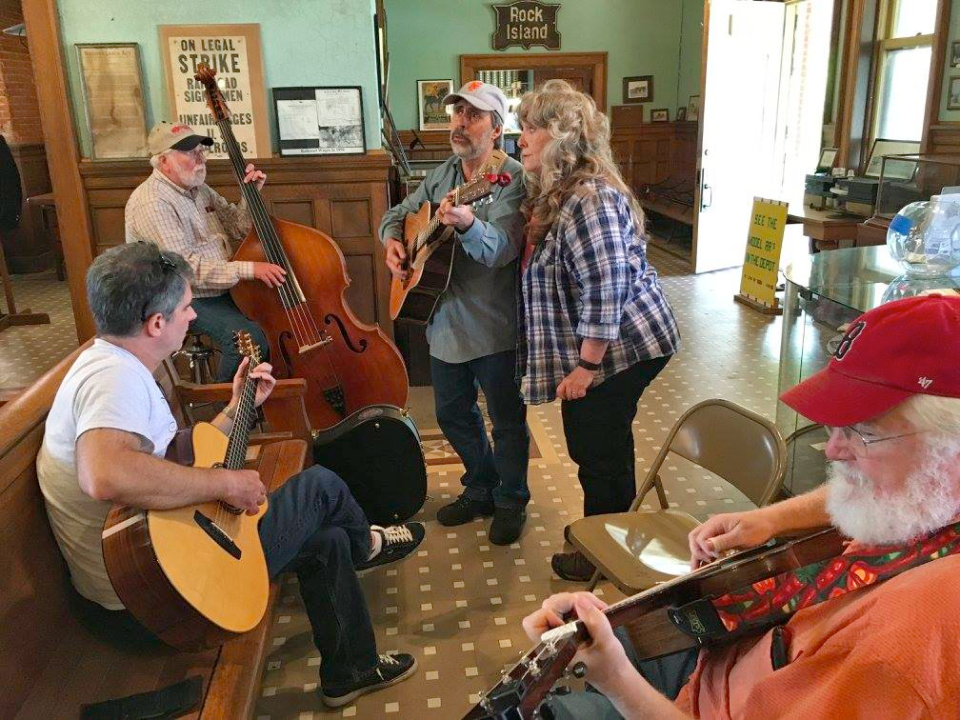 The author (center) and friends play inside the Depot museum.
