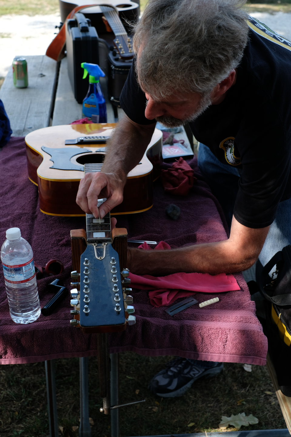 Don Penniman works the guitar setup bench, Saturday afternoon at the Depot.