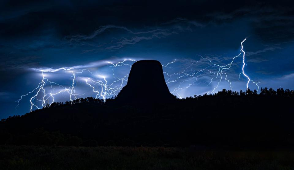 Lightning storm adds drama to Devils Tower National Monument, Wyoming.