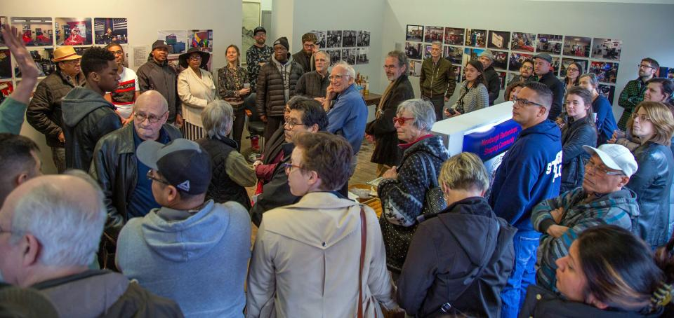 Opening reception for Newburgh Barbershops: Shaping Community with barbershop owners, coordinators Naomi Herrson-Ringskog and Gabrielle Burton Hill, Richard Ocejo, Geremy Oustatcher, and community residents at the March 2019 event