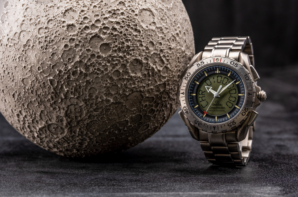 The Omega Speedmaster Professional X-33 Ref 3291.50.00 and an AstroReality moon model.