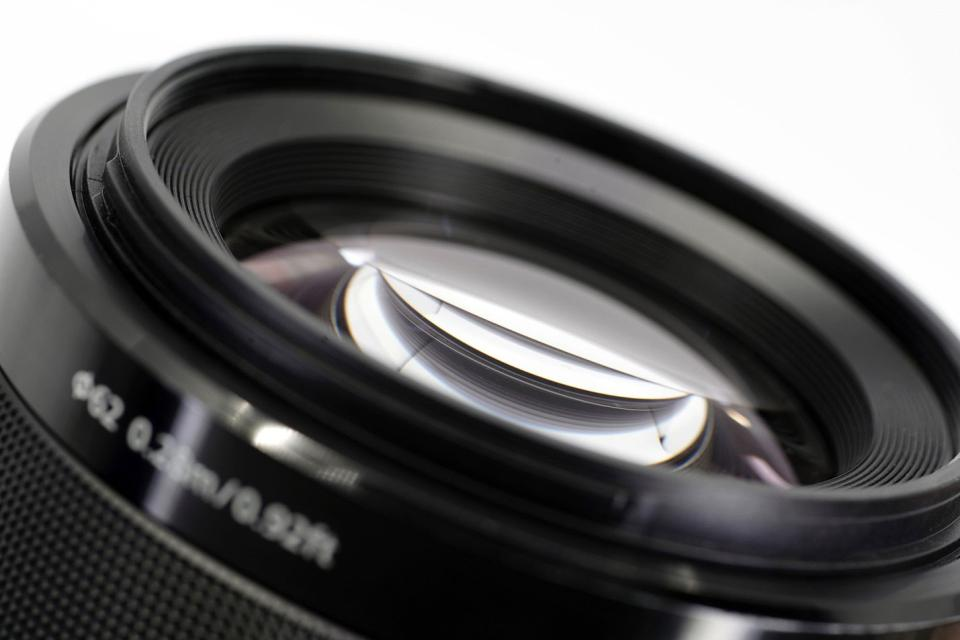 Curved-field lenses tend to display vignetting, most notably at wider apertures. Flat-field lenses are far more distortion-free compared to curved-field lenses. This is why macro lenses should be used for critical copy work and other forms of artwork and document reproduction. Conventional curved-field lenses can be used, but the results will never be critically accurate. Shown above is the front element of a Zeiss 100mm f/2.8 Makro-Planar.