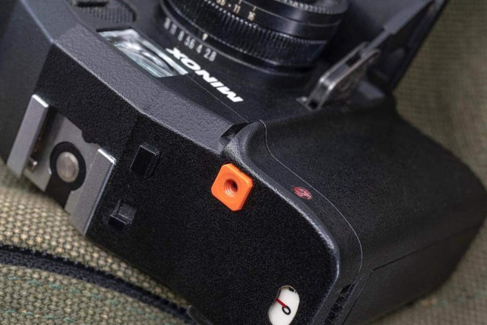 An orange shutter button with threads for a cable release became a signature stylistic touch for almost all of the 30 models of Minox 35s that were produced over the course of 22 years.