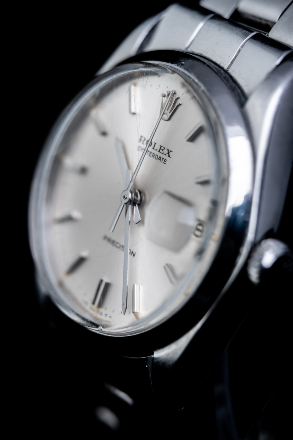 Selective focus shows the center detail of the watch face. Rolex Oysterdate Precision Ref 6694.