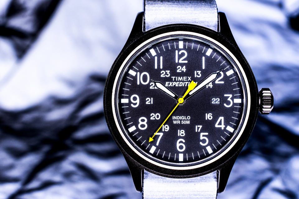 The Timex Expedition Scout 40mm Nylon watch with a reflective band and in front of reflective material. This shot was illuminated by a Bolt VM-160 LED Macro Ring Light.