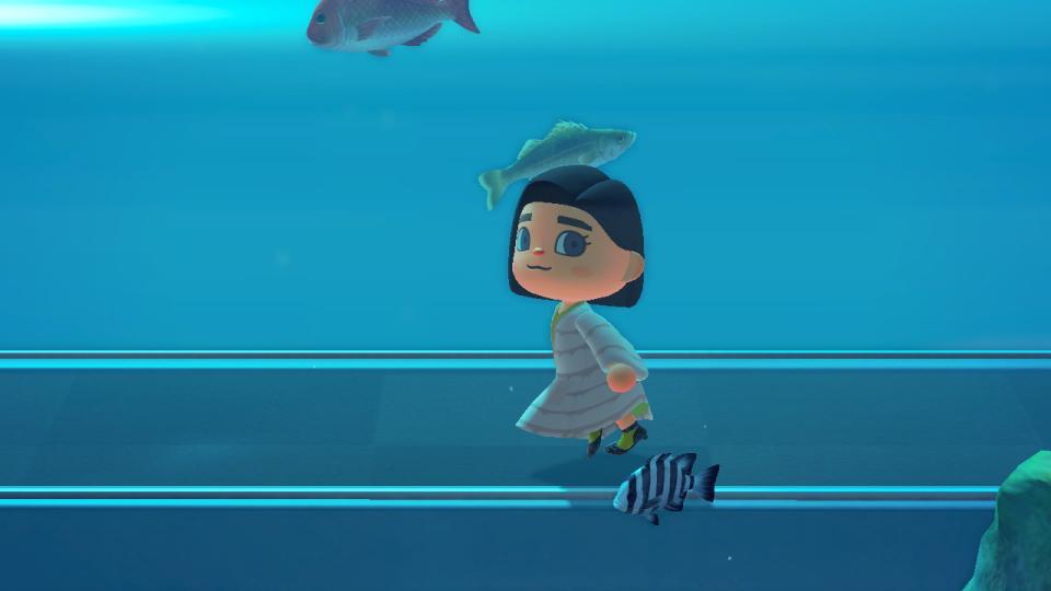 Alana's avatar dashing through the halls of the aquarium.