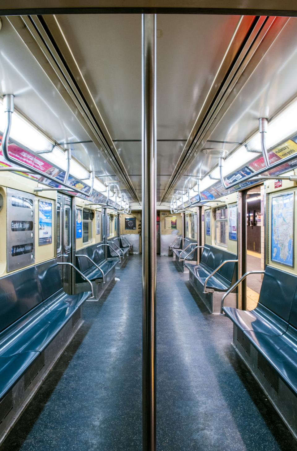 We know that most subway cars do not narrow as one walks through them. Converging lines here add depth to the scene.