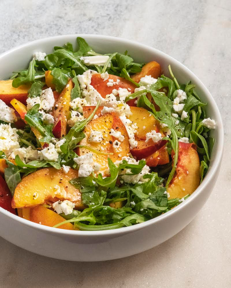 Peach Salad. This image was captured using natural light from a window and a single white card as a reflector to fill in the shadows. By looking at the shadows you can easily determine the direction of the light, a good trick when studying your favorite photographers.