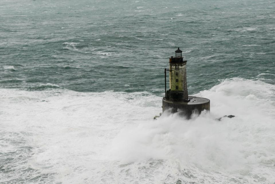 Many are familiar with the size of most lighthouses. That helps give scale to the crashing waves here.